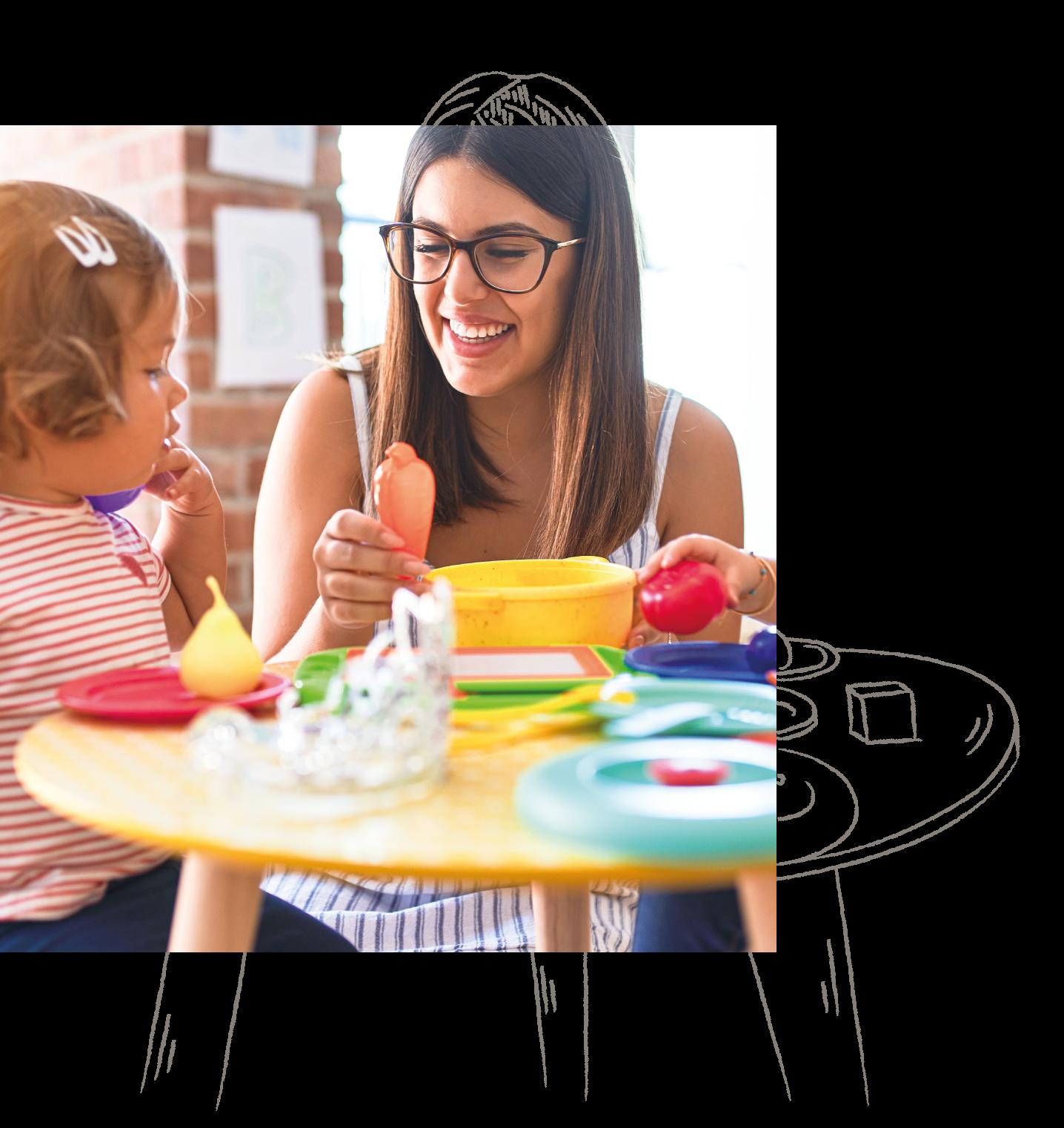 Eine bilinguale Near Native Speakerin beim spielerischen Lernen mit einem Kind in einer educcare Kindertagesstätte
